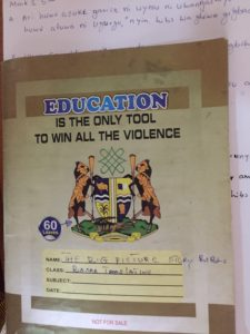 School exercise book with the slogan: Education is the only tool to win all the violence